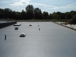 1000 m2 IKO Spectraplan on cut to falls insulation on a concrete deck